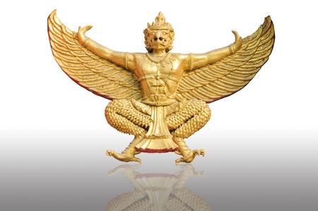 Golden garuda statue isolated white background photo