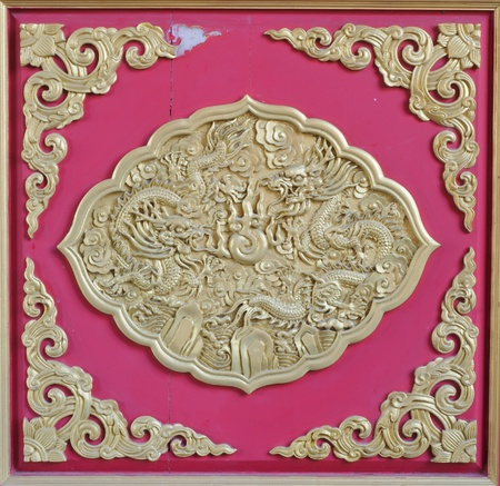 golden dragon decorated on red wood wall,chinese style in temple  photo