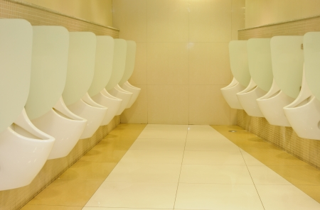 Row automatic urinals Stock Photo