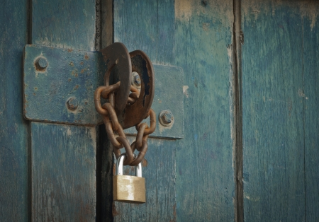 Iron lock and chain on an old  door photo