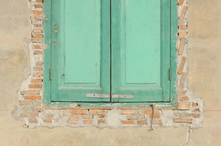 Old wooden window on old brick wall photo