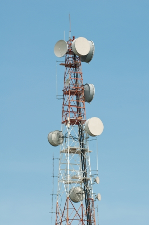 Telecommunications tower with blue sky photo