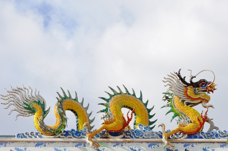 Dragons statue on the roof of Chinese temple, Suphanburi, Thailand  photo
