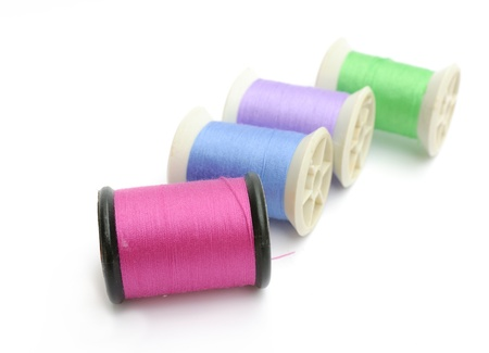 Spools of thread isolated on a white background photo