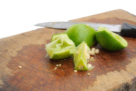 Knife and lime on wood cutting board photo