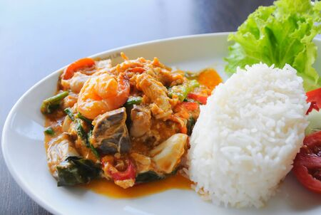Thai food. rice and shrimp with sweet and spicy sauce, stir and serve with rice photo