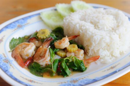 Thai food. rice and shrimp with sweet and spicy sauce, stir and serve with rice. Shallow depth of field. photo