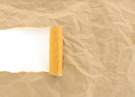 brown paper torn with copy space for text on white background photo