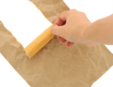 Hand man doing brown paper torn with copy space for text on white background
