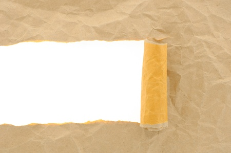rolled up: brown paper torn with copy space for text on white background Stock Photo