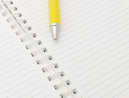Notebook with yellow pen Stock Photo - 16210888