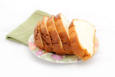 Slice of bread on the plate with white background Stock Photo