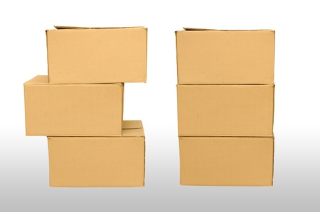 Cardboard boxes arranged on white background Stock Photo - 16330337