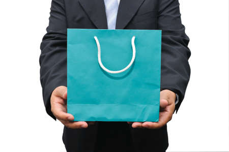Businessman holding a bag on white background Stock Photo