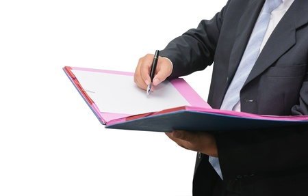 Businessman signing a document on white background
