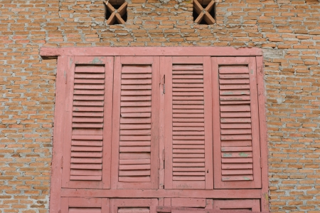 Pink wooden window with red brick background Stock Photo - 16741629
