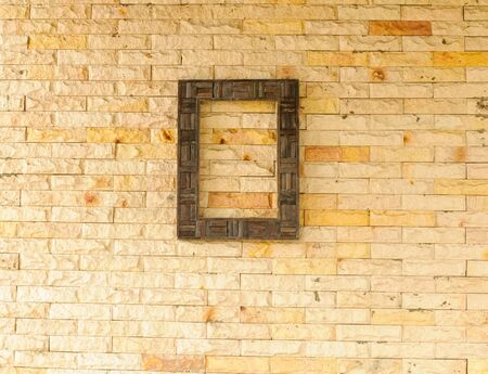 Wood frame on brick wall background Stock Photo