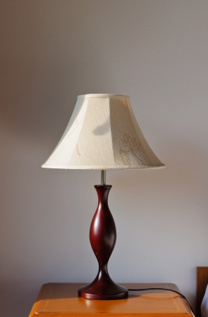 Modern lamp on bedside table photo