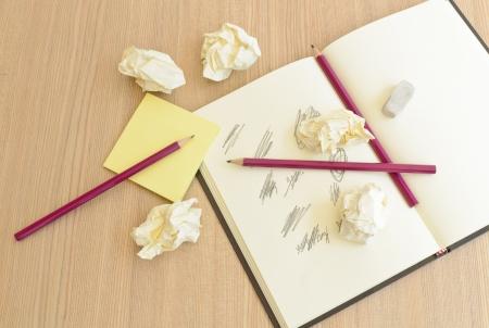 No ideas creativity problems,notebook,penclis,crumpled paper photo