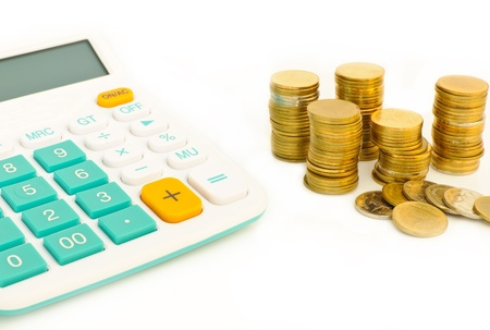 Saving money plan and calculator,stacl of coins with white background