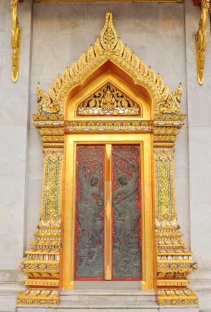 Thai temple door with beautiful in wat benchamabopitr bangkok thailand  photo