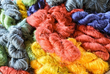 Colorful raw silk thread background in country of Thailand photo