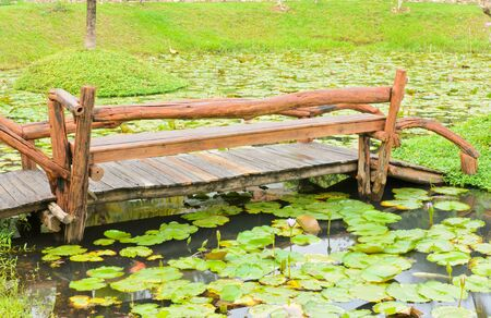 Wooden bridge over the pond. photo