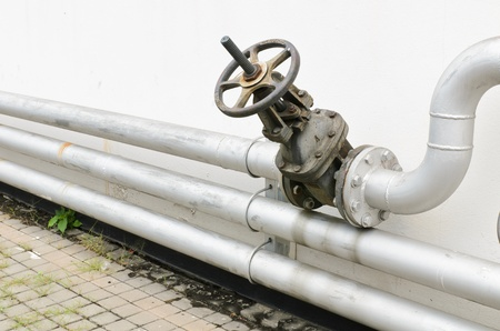 Pipeline with valve on wall