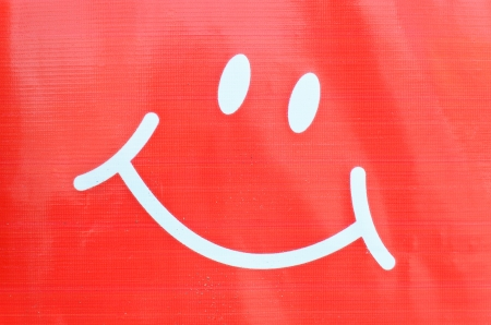 Smiley face symbol on plastic background Stock Photo