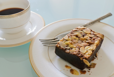 Chocolate brownie cake with almond on plate photo