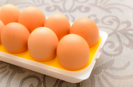 Egg in plastic tray background photo