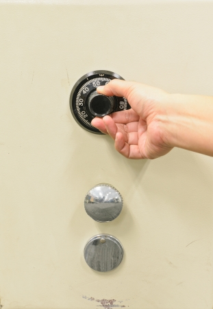 Hand opening a safe. photo
