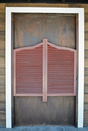 Old Western Swinging wooden Door photo