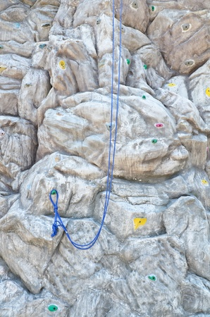 Artificial rock climbing wall background photo