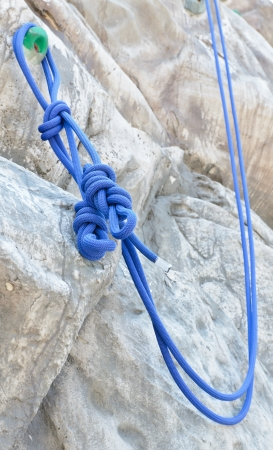 Rope with Artificial rock climbing wall background photo