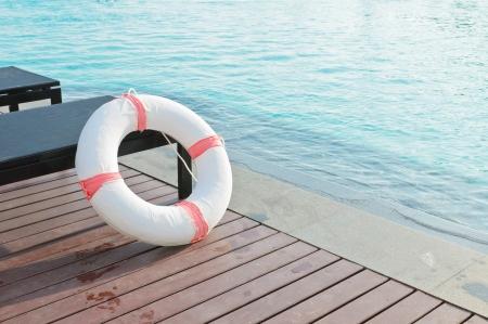 Lifebuoy beside the pool Stock Photo
