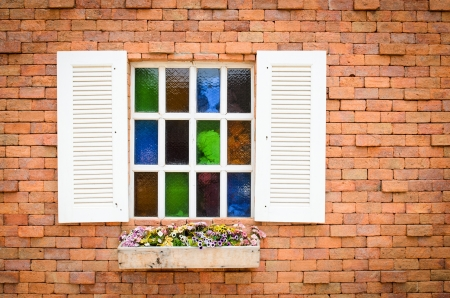 Window with brick wall red background photo