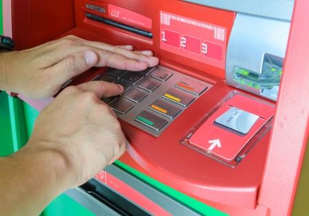 Hand using keypad atm machine  Stock Photo