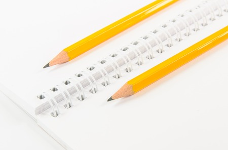 Notebook and yellow pencil with isolated white  Stock Photo
