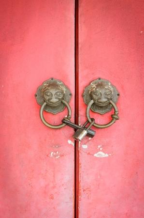 Lion head doorknocker chinese style with padlock photo