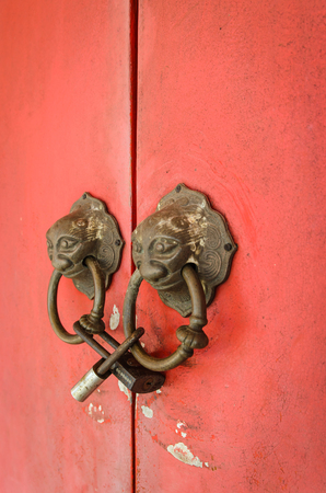 Lion head doorknocker chinese style with padlock photo