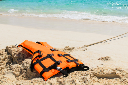 Life jacket on the beach save your life photo