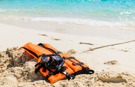 diving save: Snorkeling set and life jacket on the beach in Krabi Province,Thailand
