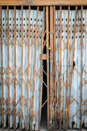 Old Grunge Steel Shutter with Rust photo