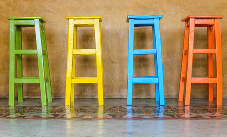 antique furniture: Colorful wooden chairs arranged tall. Stock Photo