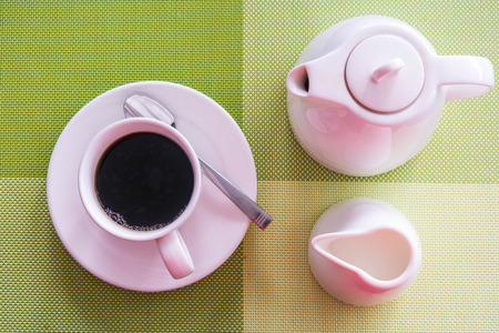 espesso: Black Coffee with milk on the table