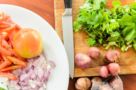 PrEP: Tomatoes,onion,coriander sliced preparation for cooking