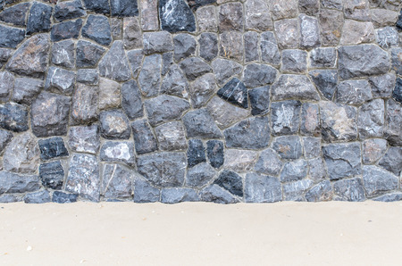 Texture of Stone wall Background in the beach