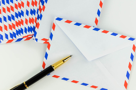 Post Envelope and Pen with White Background