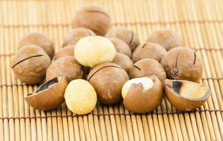 Macadamia Nuts on wooden mat